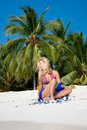 Beautiful blondy relaxing on tropical beach Royalty Free Stock Image
