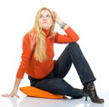 Beautiful blondy sitting on pillow and posing Stock Images