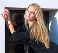 Beautiful blondy standing against door Royalty Free Stock Photo