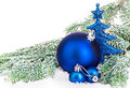 Beautiful blue Christmas balls on frosty fir tree. Christmas ornament.