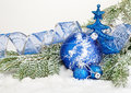 Beautiful blue Christmas balls on frosty fir tree. Christmas ornament Royalty Free Stock Photo