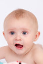 Beautiful blue eyed surprised looking baby girl face Royalty Free Stock Photography