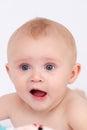 Beautiful blue eyed astonished baby girl face Royalty Free Stock Photo