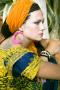Beautiful blue eyed woman with the african pigtails and by a tattoo on a shoulder Stock Photography