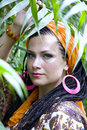 Beautiful blue eyed woman with the african pigtails among tropical plants Stock Images