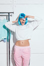 Beautiful blue hair model posing in fashion editorial studio shot.  have fun. White background. Royalty Free Stock Photo