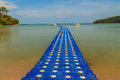 Beautiful blue pontoon made from plastic floating in the sea, ro Royalty Free Stock Photo