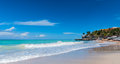 Beautiful blue sky holiday beach scene - getaway on a vacation beach in Cuba. Royalty Free Stock Photo