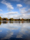 Beautiful blue sky white clouds over serpentine lake hyde park london uk Stock Images