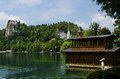 Beautiful boathouse on bled lake with bled castle in the background very Stock Photography