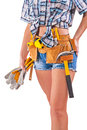 Beautiful body of female worker with tools on a white background wearing working clothes isolated Stock Photography