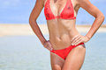 Beautiful body of woman in bikini at beach Royalty Free Stock Photography