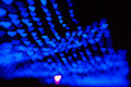 Beautiful bokeh made of warm blue blurred lights in the form of hearts on dark background Royalty Free Stock Image