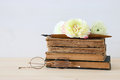 Beautiful bouquet of flowers on the old books