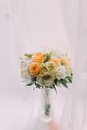Beautiful bouquet of pale white orange roses in cut glass vase on windowsill Royalty Free Stock Photo