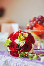 Beautiful bouquet of rose flowers on table. Wedding bouquet of red roses. Elegant wedding bouquet on table at restaurant Royalty Free Stock Images