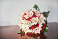 Beautiful bouquet of rose flowers, on table. Wedding bouquet of red roses. Elegant wedding bouquet on table Royalty Free Stock Photo