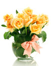 Beautiful bouquet of roses in transparent vase Stock Photos
