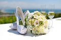 Beautiful bouquet of roses and wedding shoes Stock Images