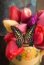 Beautiful bouquet of tulips with butterfly a spring fresh Stock Photos