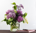 A beautiful bouquet in a vase. A bouquet of lilac branches in a beautiful jar.