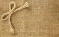 Beautiful bow on brown hemp background Royalty Free Stock Photo
