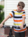 Beautiful boy with a bike Stock Photos