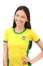 Beautiful brazilian girl attractive with flag on her yellow t shirt isolated on white Stock Photos