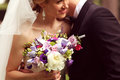 Beautiful bridal couple having fun in the park on their wedding day flower bouquet sunny Stock Images