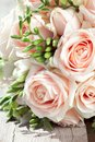 Beautiful bride bouquet white freesias pink roses Stock Photography