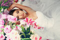 Beautiful bride in elegant dress posing amongst flowers fashion studio photo of with dark hair wedding bouquets of Stock Images