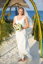 Beautiful bride getting married in beach ceremony smiling to camera Stock Photography