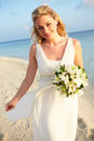 Beautiful bride getting married in beach ceremony smiling to camera Royalty Free Stock Images