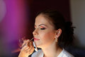 Gorgeous bride getting professional makeup on wedding day