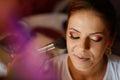 Beautiful bride getting professional makeup