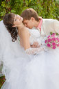 Beautiful bride and groom kissing Stock Photos