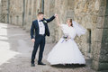 Beautiful bride and groom posing in a yard of a castle Royalty Free Stock Photo