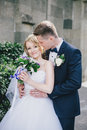 Beautiful Bride And Groom Posi...