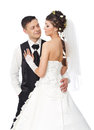 Beautiful bride and groom standing at white background wedding couple fashion shoot Stock Image