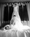 Beautiful bride on her wedding day looks at dress and the s made dresses Royalty Free Stock Photo