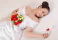 Beautiful bride holding bouquet of roses and looking at her wedding ring Stock Images