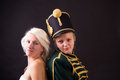 Beautiful bride and hussar posing in studio Royalty Free Stock Photo