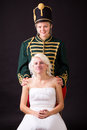 Beautiful bride and hussar posing in studio Stock Photography