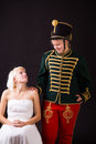 Beautiful bride and hussar posing in studio Royalty Free Stock Image