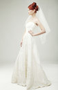 Beautiful bride in a luxurious wedding dress studio shot Stock Photos