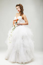 Beautiful bride in a luxurious wedding dress studio shot Stock Image