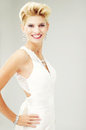 Beautiful bride in a luxurious wedding dress studio shot Stock Images
