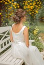 Beautiful bride portrait in rustic style. Bride hairstyle. Ivory wedding dress lace detail close up view. ivory lace up wedding dr Royalty Free Stock Photo