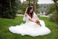 Beautiful bride posing in her wedding day Royalty Free Stock Image