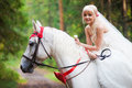 Beautiful bride riding a horse Royalty Free Stock Photo